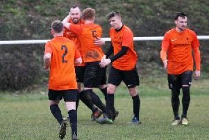 Mile Oak celebrate a goal in the win over Worthing United