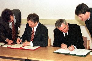 The then prime minister, Tony Blair, and his Irish counterpart, Bertie Ahern, sign the Belfast Agreement in April 1998. Mr Ahern saw the need for a late compromise on the Irish position to secure the deal, Lord Bew says. Photo: Dan Chung/PA Wire