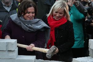 "Sinn Fein leader Mary Lou McDonald (left) and deputy leader Michelle O'Neill (right) knock down a symbolic wall that was built as part of an anti-Brexit rally at the Irish border at Co Louth on Saturday January 26, 2019. Days before in Soloheadbeg Ms McDonald spoke of the need to honour ""finish the journey, where Tipperary leads Ireland will follow. Tioch�idh �r l�.""''Photo: Brian Lawless/PA Wire"