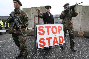 This mock checkpoint by actors is what most people assume a hard border entails - but Theresa May has signed up to a far more sweeping definition. Photo: Brian Lawless/PA Wire