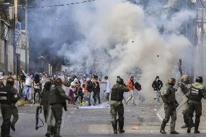Riot police clash with opposition demonstrators during a protest against the government of President Maduro January 23, 2019