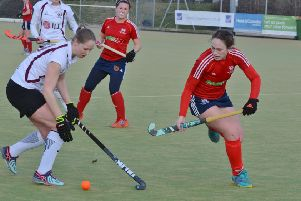 City of Peterborougth Ladies (red) in action against Wapping last weekend. Photo: David Lowndes.