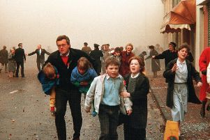 Children and adults, including elderly people, stumble away in horror after the IRA Poppy Day massacre of civilians in Enniskillen in November 1987. Picture Pacemaker