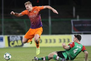 Glenavon's Andrew Mitchell takes on the Glentoran defence