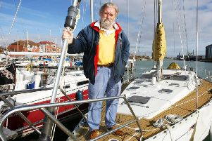 David Skinner at his boat, which is moored in Southwick