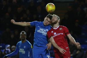 Matty Stevens (blue) playing for Posh against Walsall in December.
