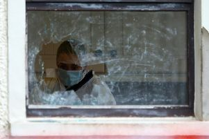 A forensic officer works at the home of David Hugh Murphy