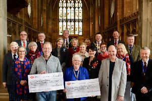 Warwick Poppies committee members with Clare Sawdon, High Sheriff of Warwickshire; Richard Eddy, Mayor of Warwick; Stephen Cross, Chairman of Warwick District Council and representatives from The Royal British Legion Poppy Appeal and St Mary's Church. Photo by Gill Fletcher.
