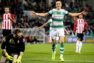 Shamrock Rovers' Aaron McEneff celebrates scoring a penalty and their second goal against Derry City.