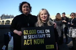 Derry Girls cast members Siobhan McSweeney and Nicola Coughlan (right) join MPS and women impacted by Northern Ireland's abortion laws on Westminster Bridge in London to demand legislative change