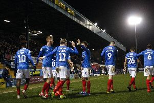 Ronan Curtis celebrates with his teammates after his goal sealed a place in the  Checkatrade Trophy.
