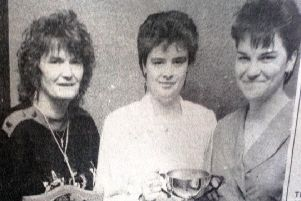 Tracy and Meg McGarry (left) winners of the Ladies' Pairs in the Larne Darts League pictured with runners-up Angela Irvine and Michelle Lamb. 1989.