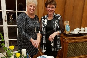Gleno WI member Shirley Kernohan baked and decorated a special 70th Anniversary cake which was cut by President Valerie Moore and Vice President Joan Arnold, pictured.