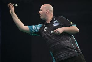 Rob Cross at the oche during his 7-1 win over Daryl Gurney in Exeter tonight. Picture courtesy Lawrence Lustig/PDC