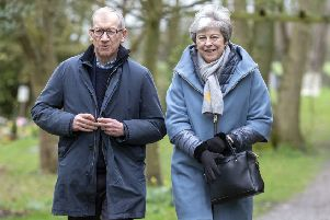 Prime Minister Theresa May leaves with her husband Philip after attending a church service near her Maidenhead constituency.