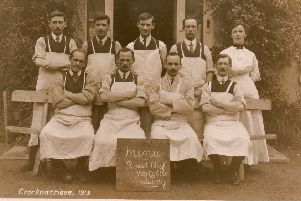 Eight men and one woman in aprons at Crocknacrieve