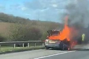The Mercedes on fire on the A1M at Sawtry. Photo: Matt Galloway