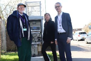 Councillor John Connor, Cabinet Member for the Environment, Kate Simons, Senior Specialist Environmental Health Technician and Simon Ballard, Environmental Protection Manager at the air quality monitoring station on Westhampnett Road.