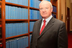 "Sir Declan Morgan, the lord chief justice of Northern Ireland. Trevor Ringland says: ""As head of our justice system he needs to respond to this matter of 700 unsolved security force murders. This should include a clear plan, with resources, to deal with these murders, bearing in mind that the law officers and soldiers gave their lives to protect the people of this island"""