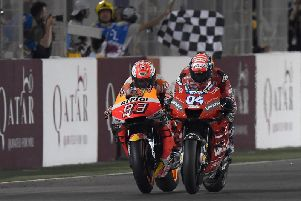 Ducati's Andrea Dovizioso held off Repsol Honda rider Marc Marquez to win the opening MotoGP race of 2019 at the Losail International Circuit in Qatar.