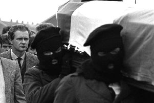 """Martin McGuinness (left) follows the coffin of IRA man Charles English in Londonderry 1984. """"McGuinness died without uttering any meaningful apology or revealing the truths he knew to IRA victims"""" Picture Pacemaker"""