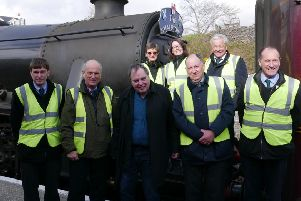 The late Nigel Dobbing (centre) with colleagues from The Railway Touring Company EMN-190314-100852001