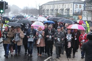 Families of those killed on Bloody Sunday march through the Bogside in Londonderry ahead of the announcement on prosecutions. Pic: Niall Carson/PA Wire