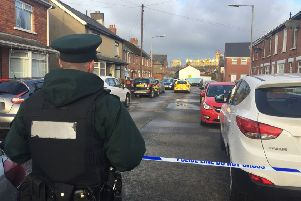 Police and forensics at the scene in Kyle Street, east Belfast, after a man died in a house in the street early on Friday morning. Pic by: David Young/PA Wire