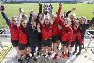 Katie Hetherington and Enniskillen Royal GS celebrate their cup final win over Loerto SS at Kingspan Stadium
