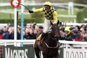 Jockey Paul Townend celebrates his victory in the Magners Cheltenham Gold Cup Chase on Al Boum Photo.