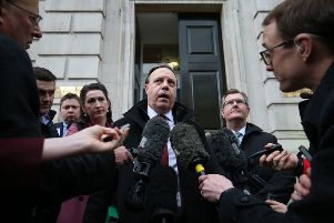 Nigel Dodds, deputy leader of the Democratic Unionist Party, speaks outside the Cabinet Office in London's Whitehall on Friday