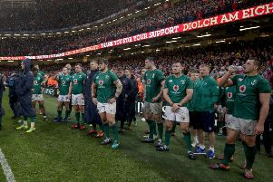 Ireland players dejected after the 25-7 loss to Wales in Cardiff