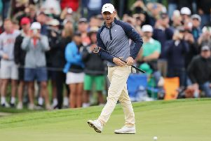 Rory McIlroy of Northern Ireland reacts on the 18th green during the final round of The PLAYERS Championship on The Stadium Course at TPC Sawgrass
