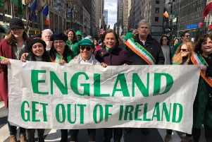 Sinn Fein leader Mary Lou McDonald posted the picture of herself (centre) behind the banner along with Irish republican supporters in the US