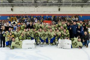 Phantoms players and officials line up with the NIHL South Cup.