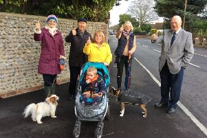 Councillor George Barton, councillor Carol Albury, chairman of the neighbourhood panel Ken Carr, and residents Virginia Kemp with Tuppany, Nicky Prior with grandson Ledley and Kie the dog