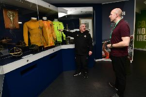 Allen Patton gives 'Graeme Cousins a tour of the museum at the National Football Stadium at Windsor Park.' Photo Colm Lenaghan/Pacemaker Press