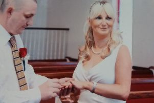 Julie and her husband Martin McMullan on their wedding day