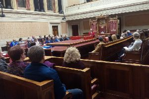 Anne Graham, sister of the late Edgar Graham, speaks at the end of the Edgar Graham Memorial speaking competition, in the senate, Stormont, March 20 2019