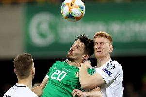Northern Ireland's Craig Cathcart with Estonia's Madis Vihmann