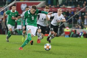 Northern Ireland's Steven Davis scores a penalty against Estonia