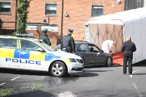 24/3/19 PACEMAKER PRESS'Police forensics remove a car from the grounds of Belfast City Hospital after an incident.
