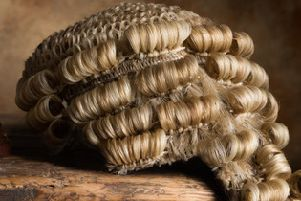 Judge's court wig and hammer or gavel