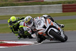 Carl Phillips (J McC Kawasaki) leads Alistair Kirk (McCurry BMW) at the Ulster Superbike meeting at Bishopscourt on Saturday. Picture: Pacemaker Press.