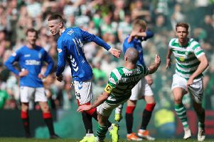 Rangers' Ryan Kent (left) and Celtic's Scott Brown clash