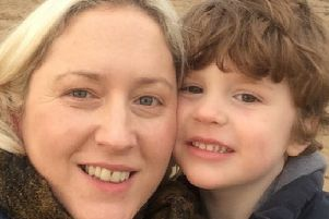 Tara McIntyre with her son Matthew, who she said has been on the autism diagnosis waiting list for more than a year