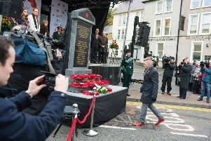 Family members of victims of the Enniskillen bomb lay wreaths at the memorial to honour the victims of the Enniskillen bomb which was unveiled at Belmore Street, Enniskillen on the 30th Anniversary of the bombing. The memorial was put into storage immediately afterwards. Picture: Ronan McGrade/Pacemaker