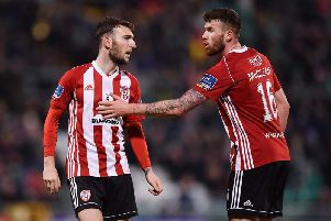amie McDonagh of Derry City, left, is ushered from the field by team-mate Patrick McClean after being sent off in Tallaght.