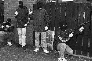 """IRA men on patrol in the Markets area of Belfast 1992. """"The focus on security force killings ties up limited resources in a way that ensures they're not available to hold the main perpetrators to account"""""""