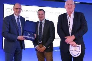 NI Football League managing director Andrew Johnston (centre) and chairman Brian Adams (right) are presented with a certificate of membership by Lars-Christer Olsson (European Leagues president).